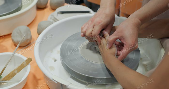 Prepare to make a clay pot in studio