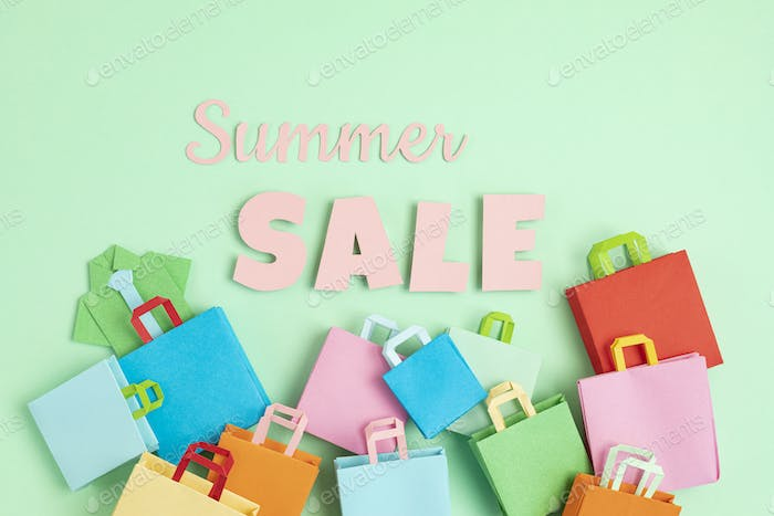 Word Sale and shopping paper bags. Sesonal sale, online deals, discounts, promotion, shopping