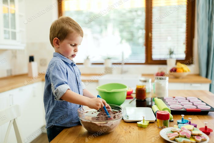 Cute child learning to become a chef