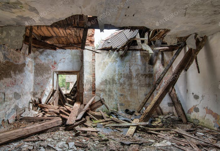 Leaky roof - interior of the old, abandoned and crumbling buildi