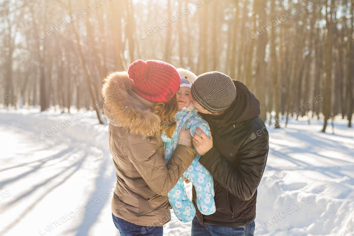 Happy family - Mother, father and child boy on a winter walk.