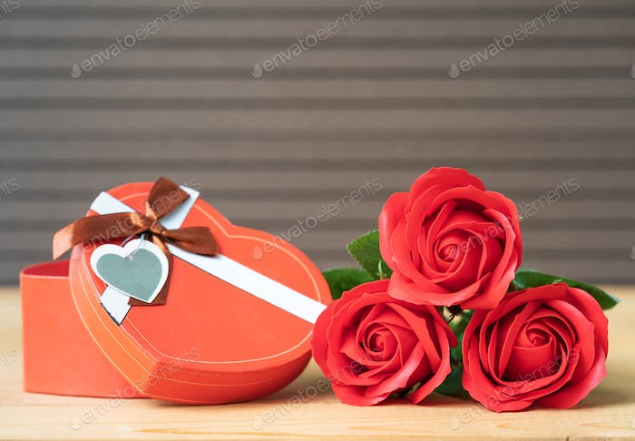 Red roses and heart-shaped box on wood-13