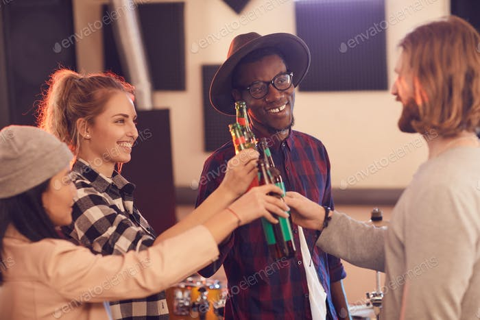 Group of Young People Drinking Beer
