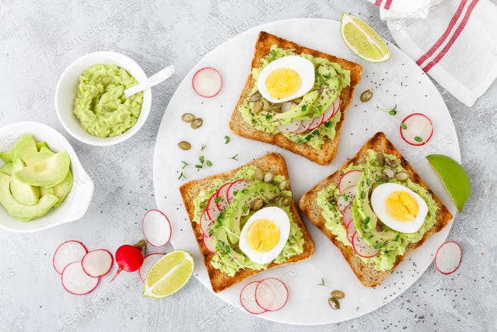 Sandwiches with avocado guacamole, fresh radish
