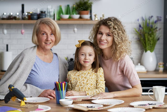 Portrait of three generations of women during Easter