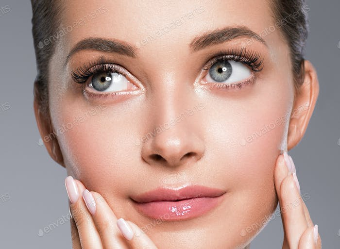 Beautiful eyes and lips healthy clean skin woman portrait close up