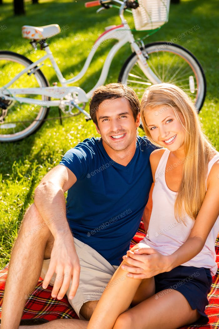 Couple relaxing in park.