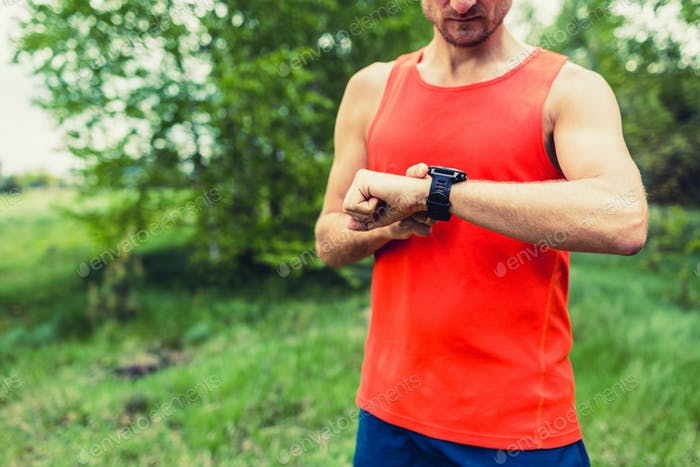Runner looking at sport smart gps watch