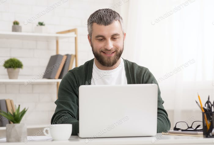 Smiling entrepreneur working from home, chatting with suppliers