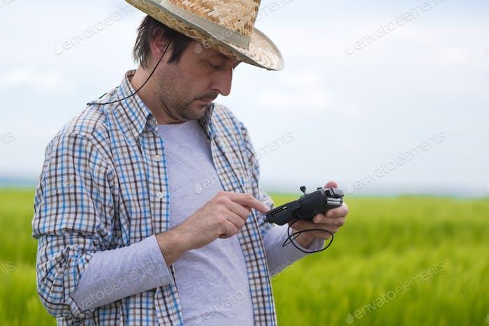 Smart farming concept, farmer using drone in field