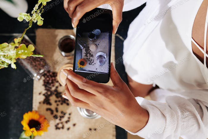 Woman photographing flatlay