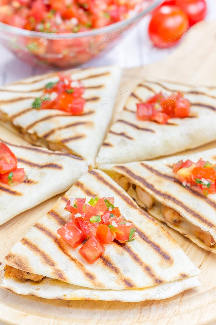 Homemade chicken and cheese quesadilla with salsa