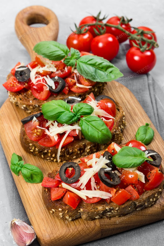 Bruschetta with fresh tomato, basil, cheese and olive