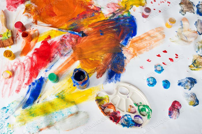 Children drawings with paints, brushes and palette