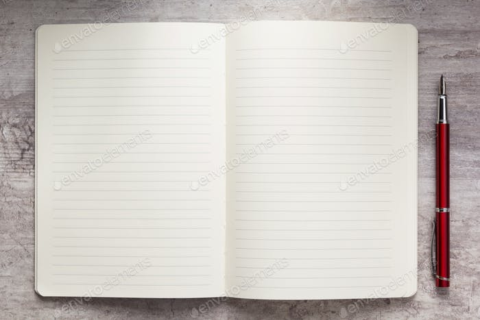 notepad or notebook paper at stone background