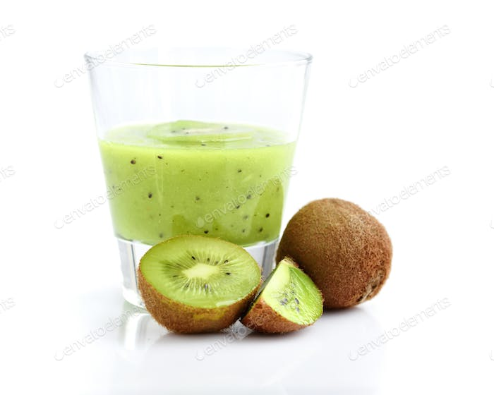 Smoothies of kiwi in glass with fresh fruits on white background