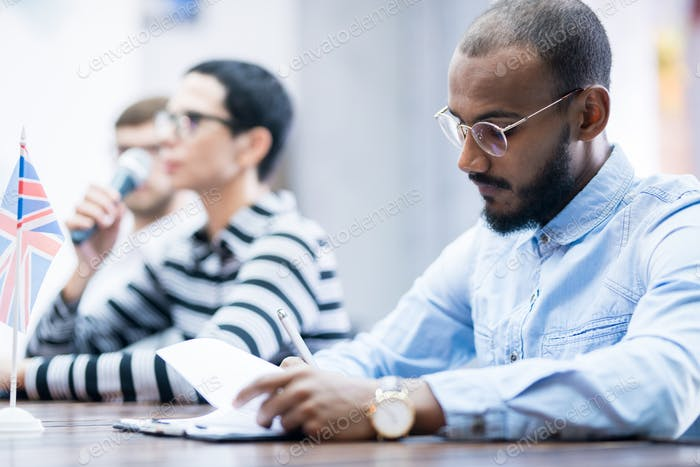 Businessman sitting at conference