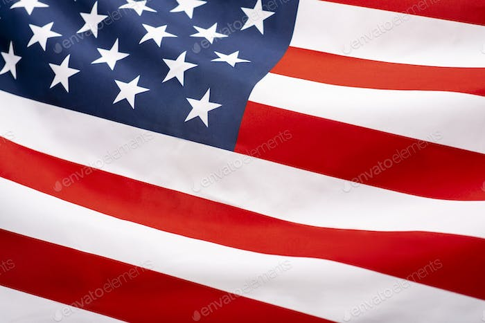 Image of the american flag flying in the wind