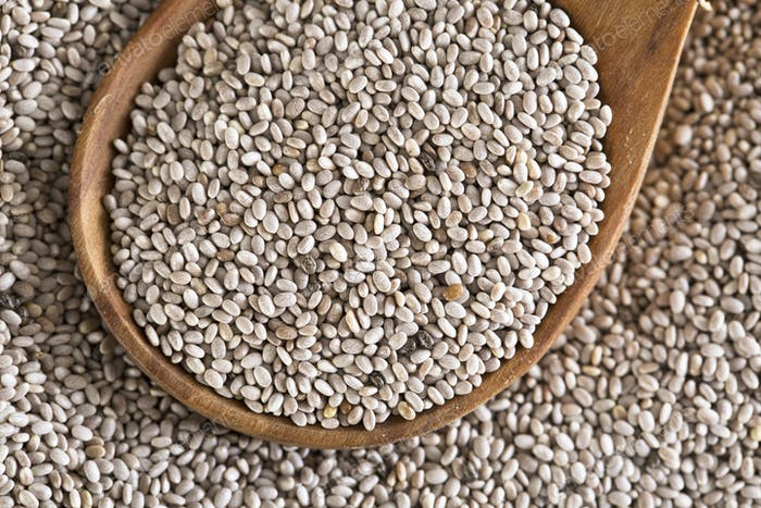 White Chia Seeds in Wooden Spoon