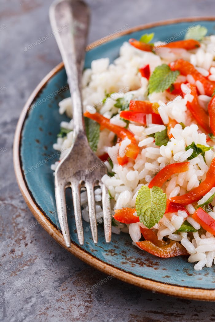 Salad with rice, sweet pepper, chili pepper and mint.
