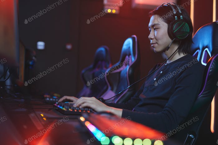Young Asian Man Playing Videogame