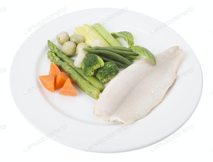Steamed trout fillet with vegetables.
