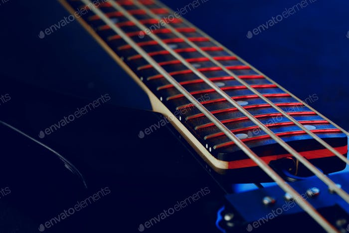 Guitar fingerboard with strings close up photo