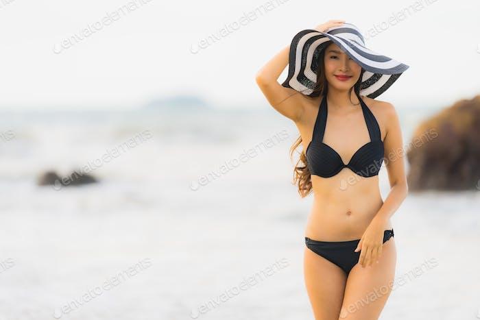 Portrait beautiful young asian woman wear bikini on the beach se