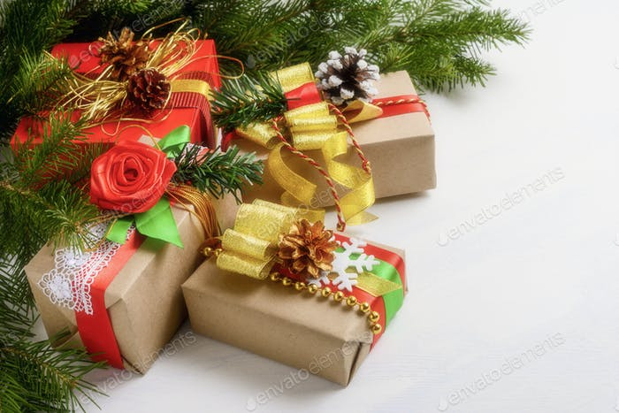 Christmas boxes presents with fir branches