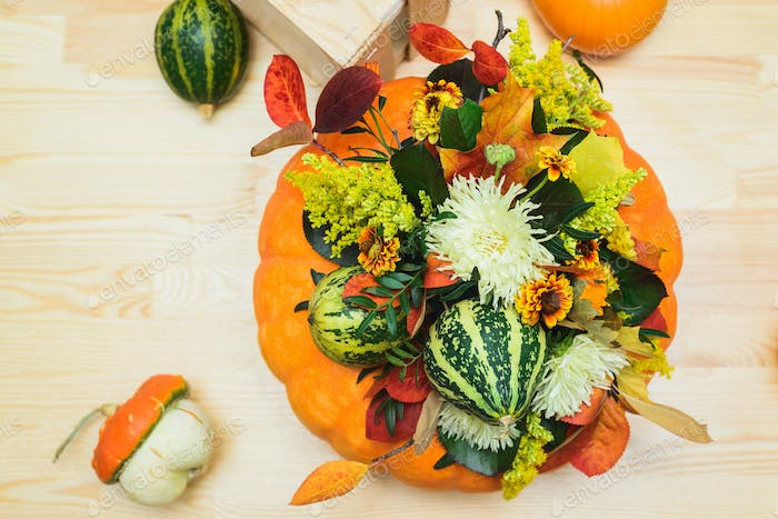bouquet of pumpkins, flowers and leaves