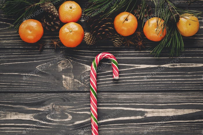 tangerines with cones and anise on rustic wooden background