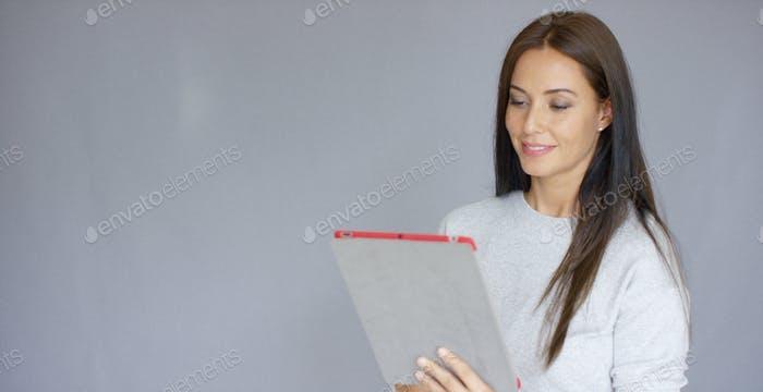 Beautiful middle aged woman using tablet computer