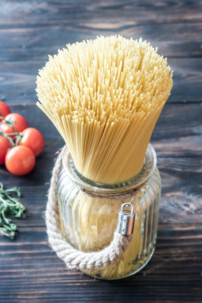 Uncooked spaghetti in the glass