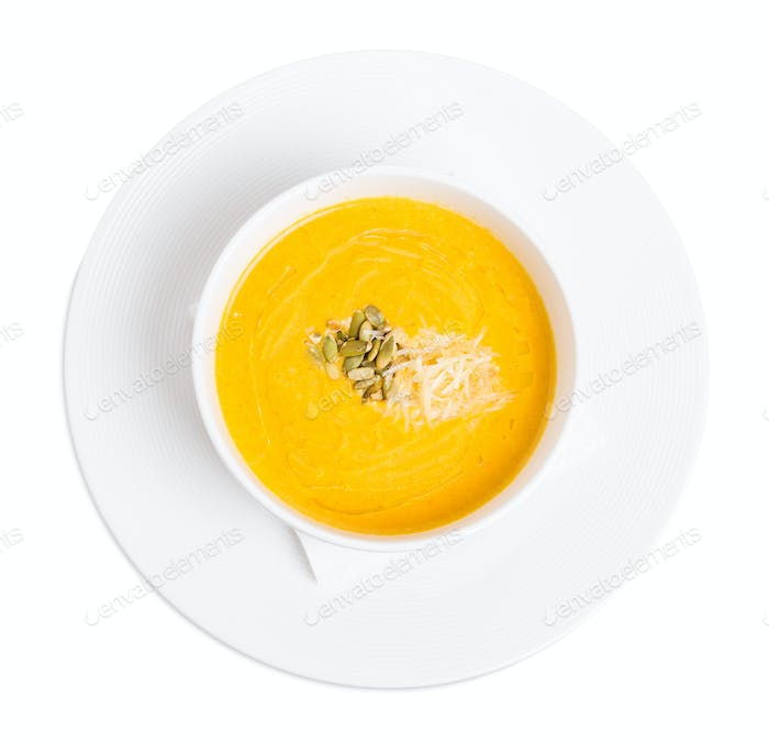 Pumpkin cream soup with grated cheese.