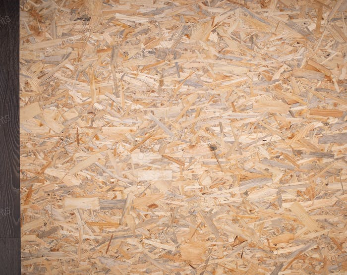 Chipboard background texture. Wooden osb surface