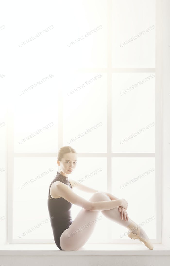 Classical Ballet dancer portrait at window background