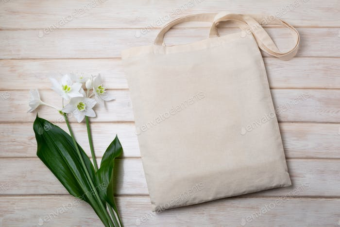 Rustic tote bag mockup with white lily