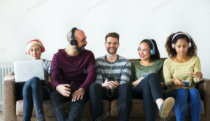 Group of people enjoying music streaming