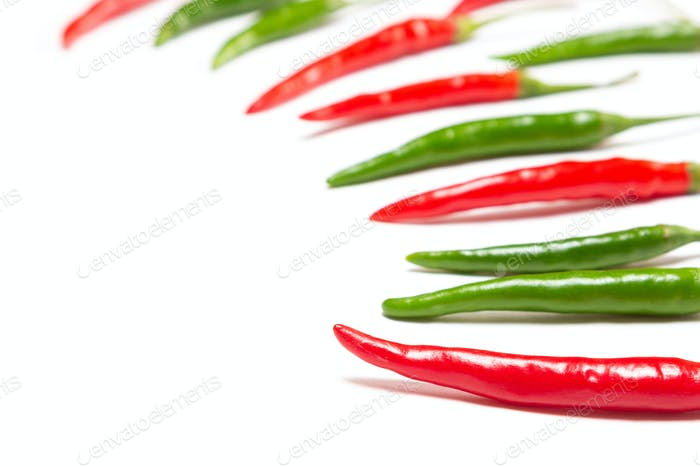 Red and green chili peppers on white background with copy space