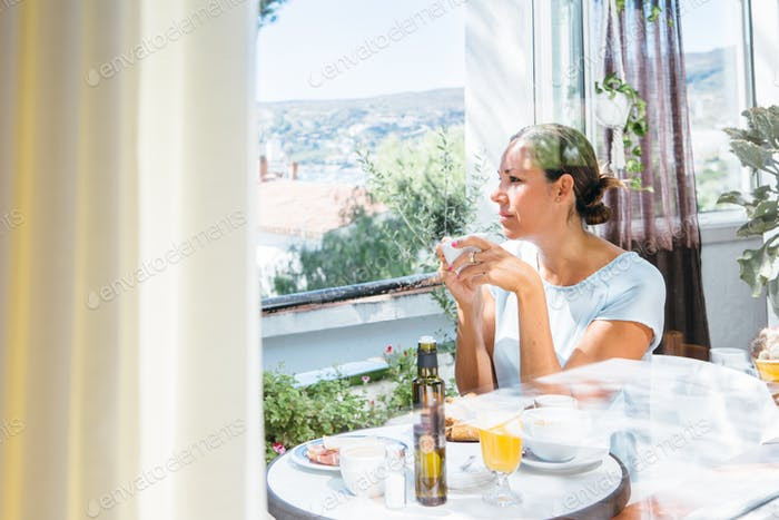 Woman with cup on terrace