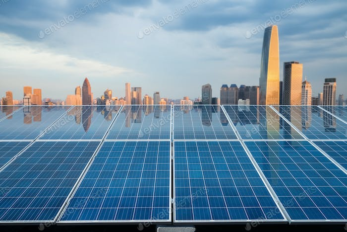 solar energy panel with city twilight