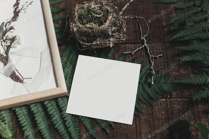 wedding invitation mock-up and rustic boutonniere under glass frame