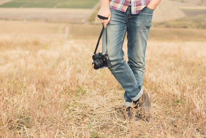 Attractive male photographer outdoors at sunset