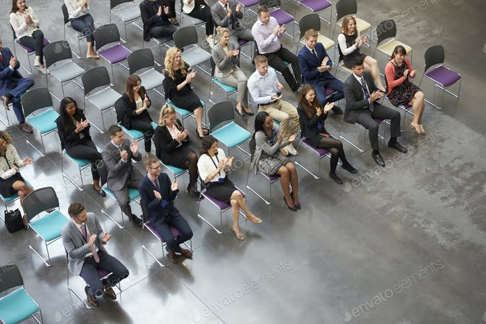 Thumbnail for Overhead View Of Audience Applauding Speaker At Conference