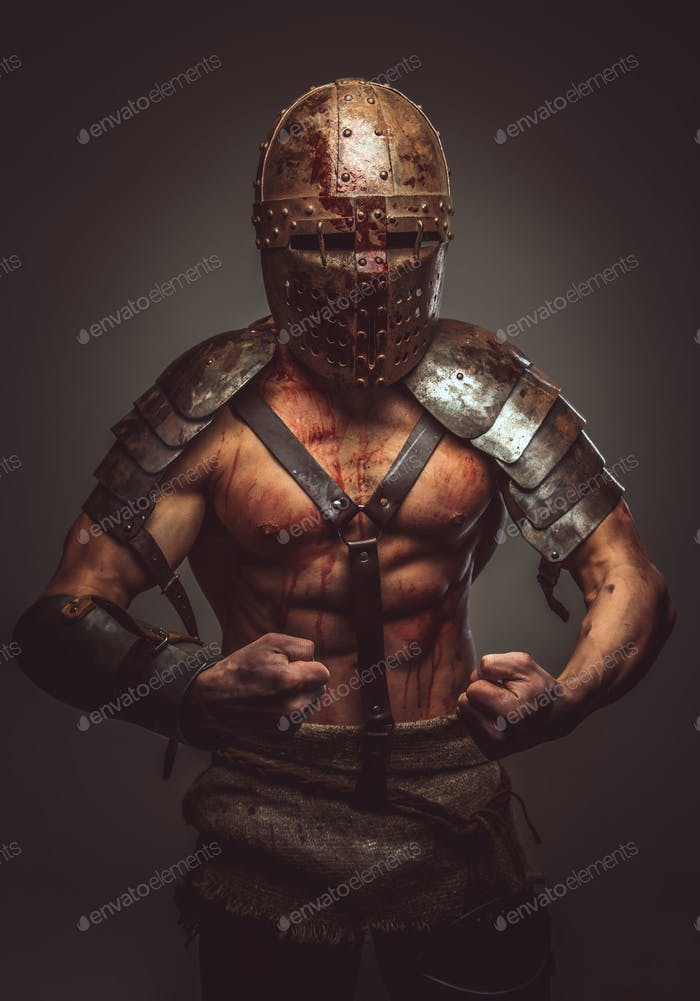 Angry bloody gladiator in helmet and ancient armor.