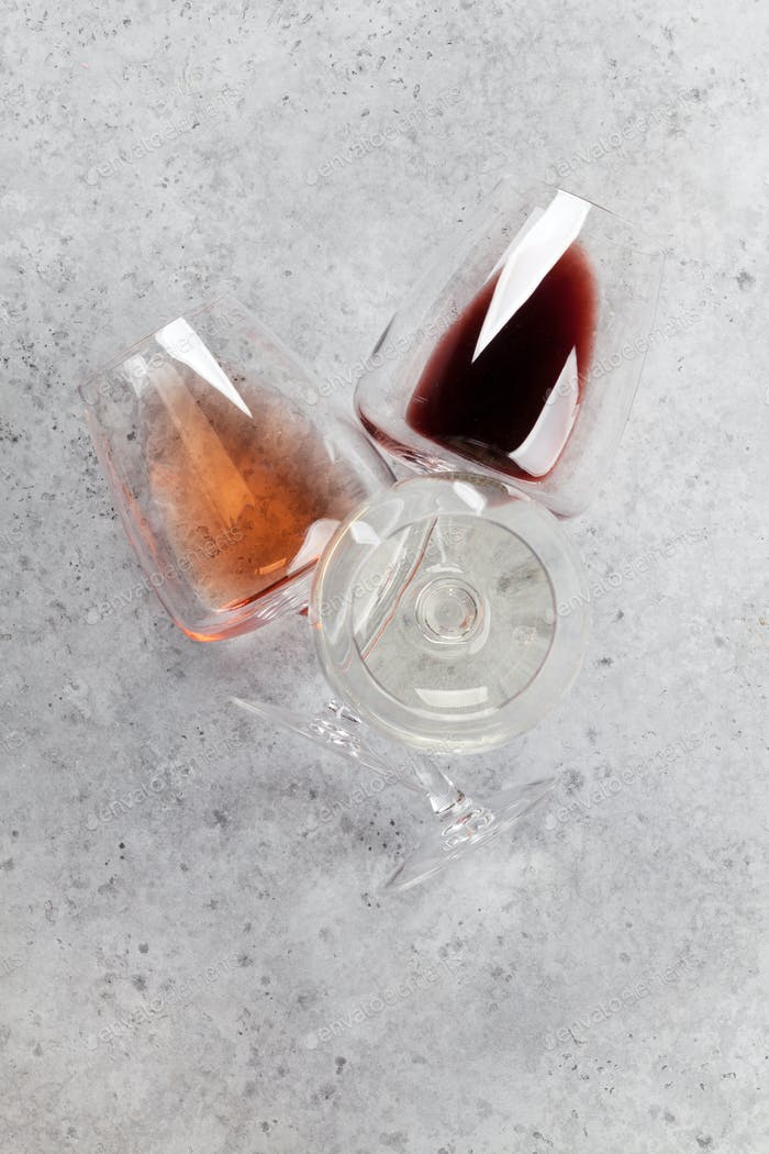 Various wine glasses on stone table