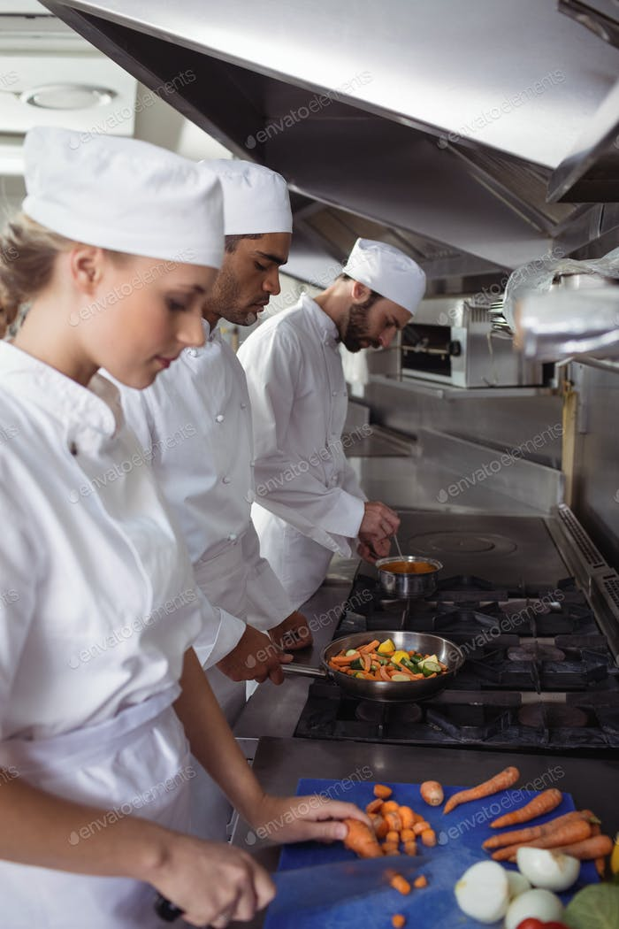 Chefs chopping vegetables