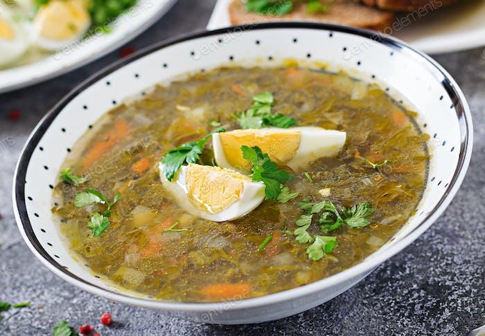 Green sorrel soup with eggs. Summer menu. Healthy food.