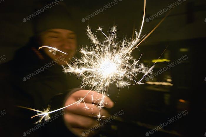 Man holding sparkle