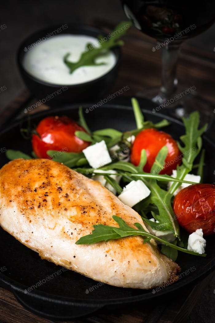 Grilled chiken fillet and fresh vegetables salad.
